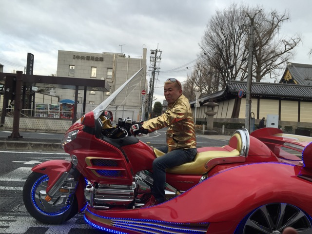 Gold lame biker in Kyoto